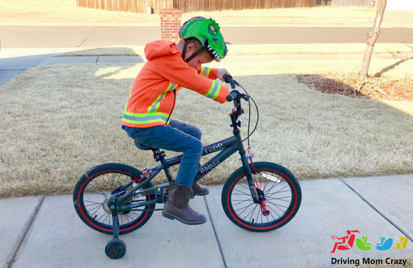 child riding bike with hoodie on